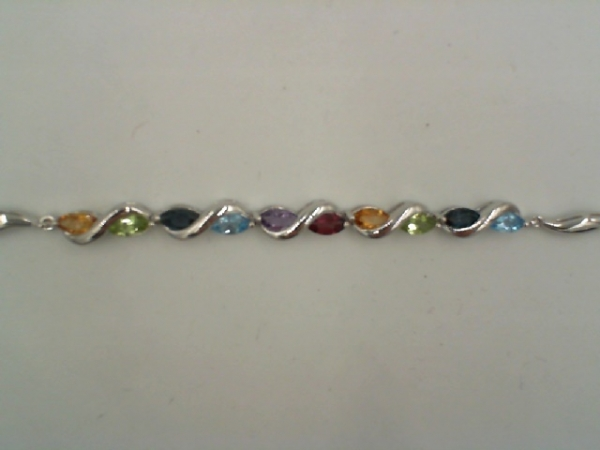 Bracelet - Lady's White Sterling Silver Bracelet Length 7.5 2= Marquise Citrines 2= Marquise Peridots 2= Marquise London Blue Topazs 2= Marquise Blue Topazs one Marquise Amethyst one Marquise Rhodolite Garnet Ctw = 2.20