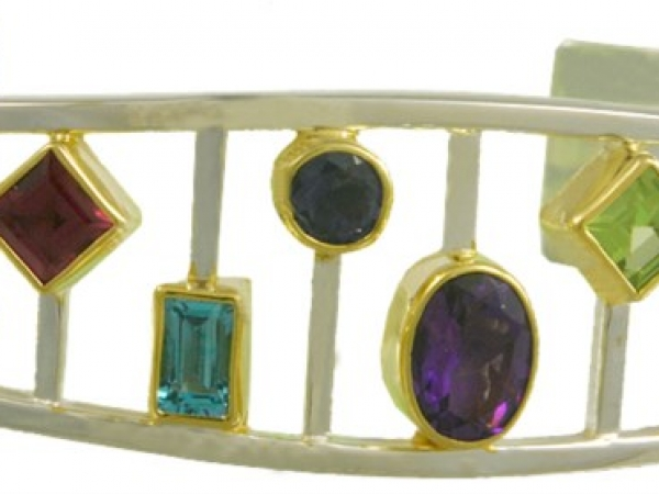 Bracelet - MICHOU Sterling Silver/ 22 Karat Vermeil Cuff Style Multi-Stone Bracelet 2= Various Shapes Peridots 2= Various Shapes Rhodolite Garnets 2= Various Shapes Blue Topazs one Oval Amethyst one Round Iolite