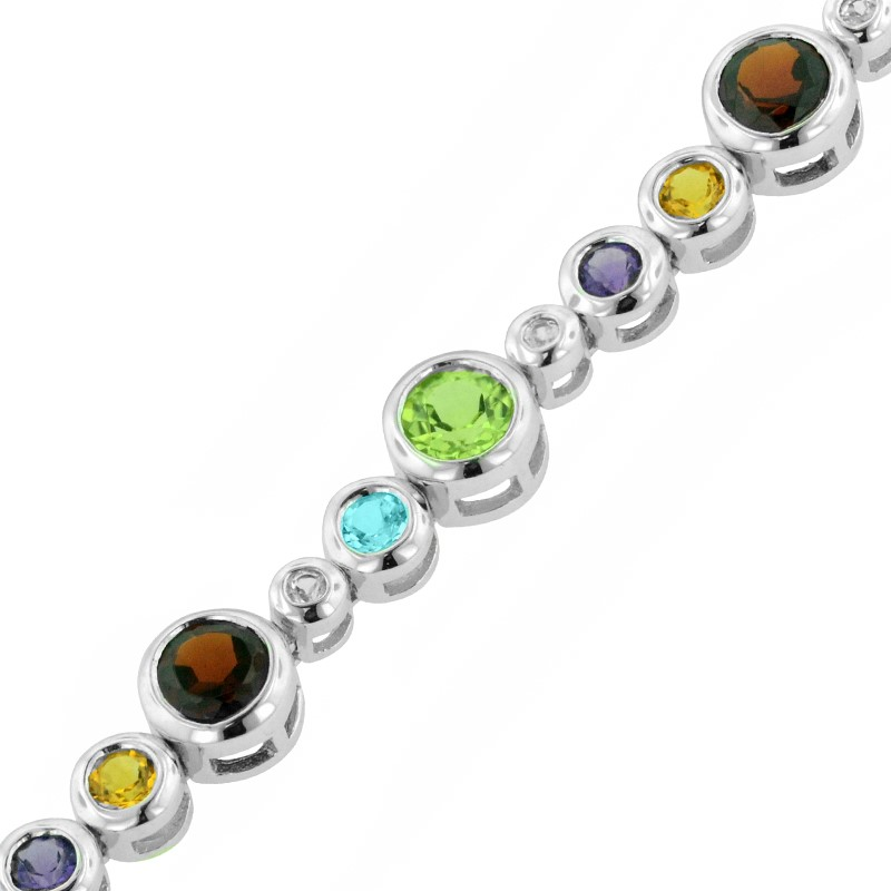 Silver Bracelet w/Colored Stones - Lady's SilverBezel Bracelet with 4.42tcw in Colored Stones 6= Round Amethysts 5= Round Blue Topazs 6= Round Citrines 4= Round Peridots 6= Round Garnets 4= Round Peridots 11= Round Quartzs Style: Line Metal: Sterling w/ Rhodium Finish Color: White Length: 7 Finish: Polished