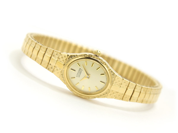 Ladies Watch - CITIZEN QUARTZ EK3682-97P Gold-tone watch with oval logo'd dial and diamond pattern etched on linked expansion bracelet, Japanese quartz movement with analog display, Protective mineral crystal dial window, Features expansion band closure, Water resistant to 99 feet (30 M): withstands rain and splashes of water, but not showering or submersion