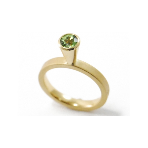 Mini Mini Ring, 5mm - Designer: Georg Spreng Style: Mini Mini Ring, 5mm Metal: 18-karat yellow gold, matte finish shank with high polish bezel, 2.5mm wideStone: 0.61 carat round faceted peridot, 5mmFinger Size: 6.75 US