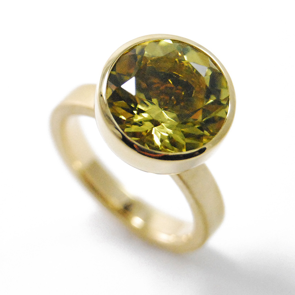 Blub Ring, 12 mm - Designer: Georg Spreng Style: Blub Ring, 12 mm Metal: 18-karat yellow gold, matte finish shank with high polish bezel, 3 mm wideStone: 5.71 carat round faceted yellow-green Citrine, 12 mm Finger Size:  7 US