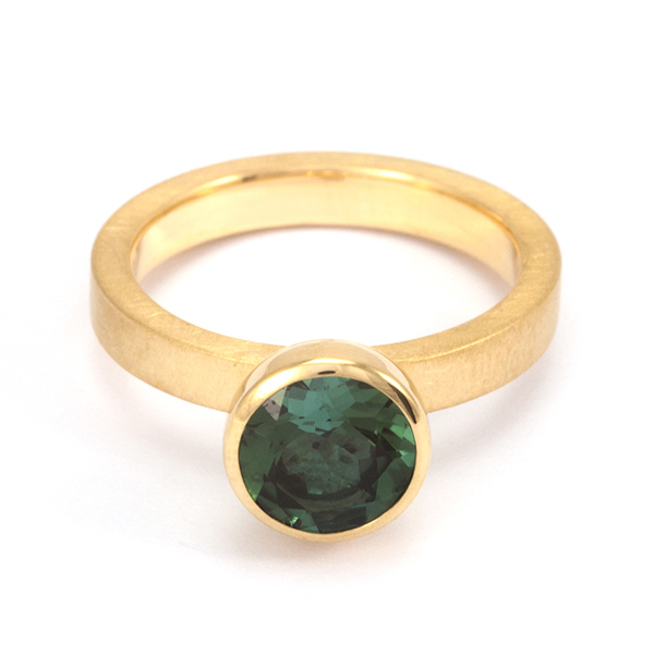 Blub Ring, 10mm - Designer: Georg SprengStyle: Blub Ring, 10mmMetal: 18-karat yellow gold matte finish schank with high polish bezelStone: 8mm round faceted blue-green tourmalineFinger Size: 7