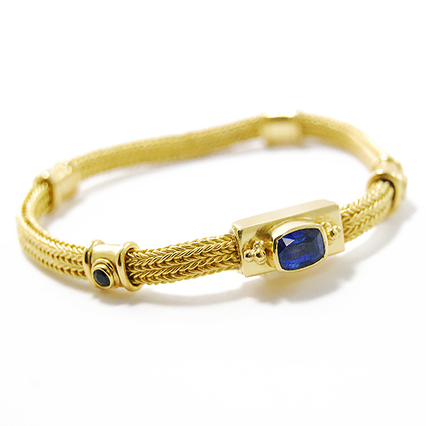 Sapphire Mesh Gold Bracelet - Designer: Bikakis and JohnsStyle: Sapphire Mesh Gold BraceletMetal: 18, 20 & 22-karat yellow gold Width: 5 mmStones: one rectangular faceted Blue Sapphire, 1.16 carat (7.2 mm  x 5.6 mm)  and four ound diamond-cut Blue Sapphires, 0.49 carats total weight, 3 mm eachLength: 7 inches
