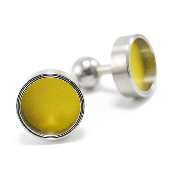 Cufflinks - Designer: Carl DauStyle: CufflinksMetal: Stainless steel with yellow varnish interiorDiameter: 16mm