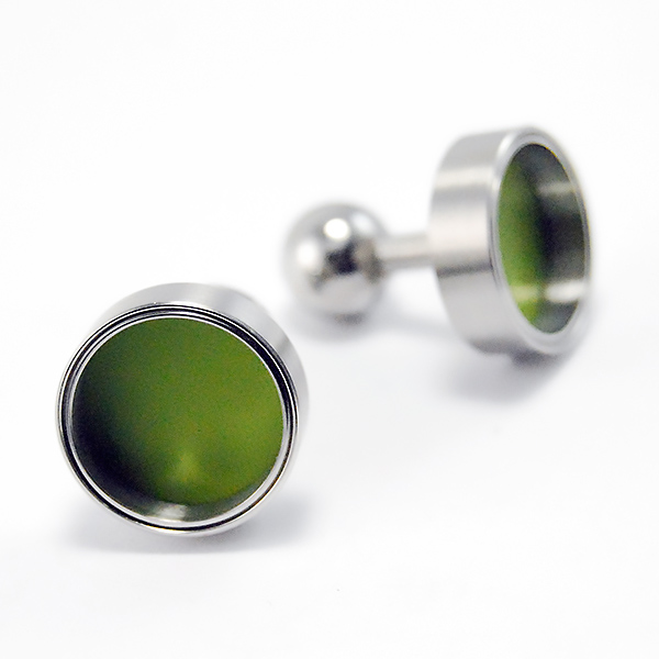 Cufflinks - Designer: Carl DauStyle: CufflinksMetal: Stainless steel with green varnish interiorDiameter: 16mm