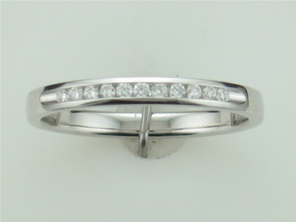 Wedding Band - Ladies 14 karat white gold channel set diamond band 11=.10ct. twt. H in color SI2 clarity