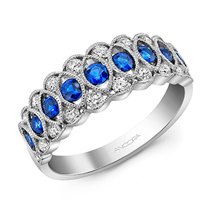 Anniversary Ring - Ladies 14 karat white gold diamond and sapphire ring 20=.42 ct.  diamond total weight and 9=.57ct. sapphire total weight H in color VS2 clarity.