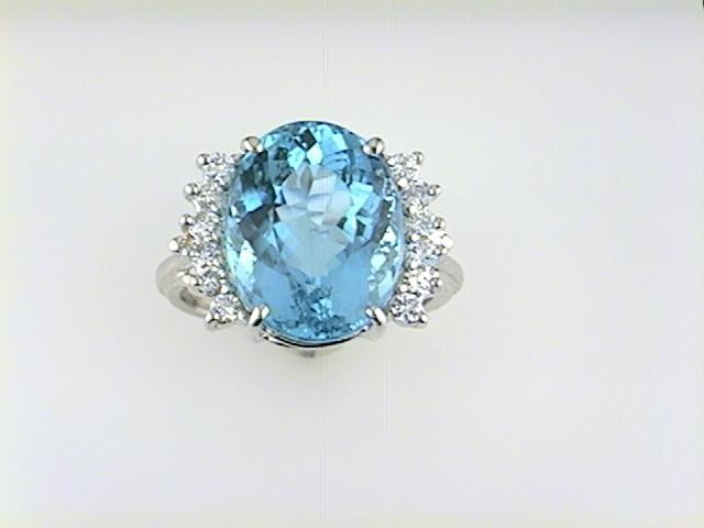Fashion Ring - Lady's White 14 Karat Ring With One 8.60Ct Oval Shape Aquamarine And 12=0.42Tw Round Diamonds- H/I Color, SI1/SI2 Clarity