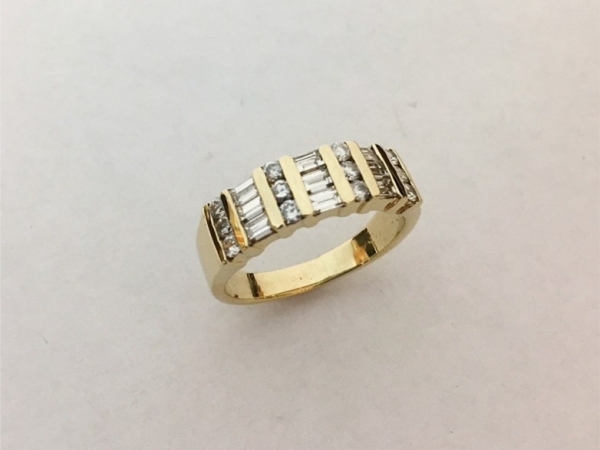 Wedding Band - Estate Piece! 1.00ctw diamond baguettes and rounds set into 14ky gold.  Size 8.75