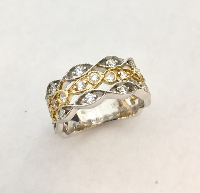 Anniversary Ring - New Piece! .66ctw diamonds set into a 3 row milgrain two tone band in 14k yellow and white gold.