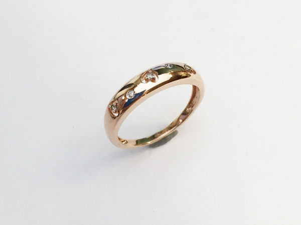 Fashion Ring - Estate piece! Diamond heart band in 14kr gold, size 7. This ring can be sized, please call for pricing.