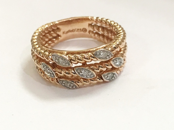 Fashion Ring - Kallati designer ring with .10ctw diamonds set into white gold in a three row rope 14k rose gold band, size 6.5. This ring can be sized, please call for pricing.