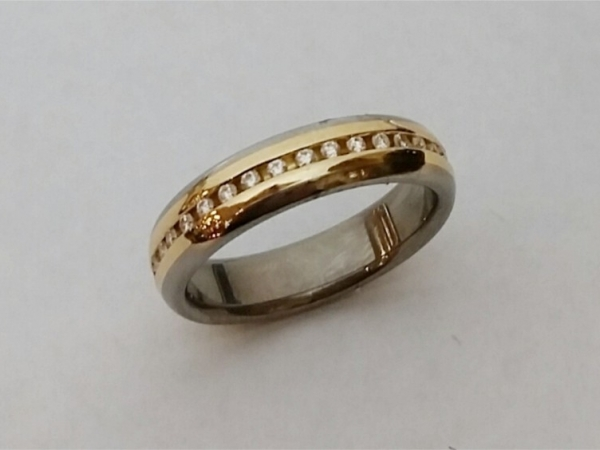 Fashion Ring - Estate piece! Titanium and 18ky gold diamond band, size 8. This ring can be sized, please call for pricing.