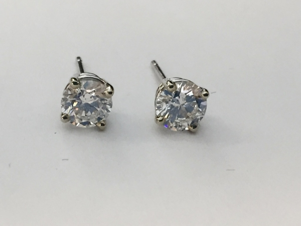 Earrings - New piece! 1ctw F color SI2 clairty diamond studs in 14kw gold.