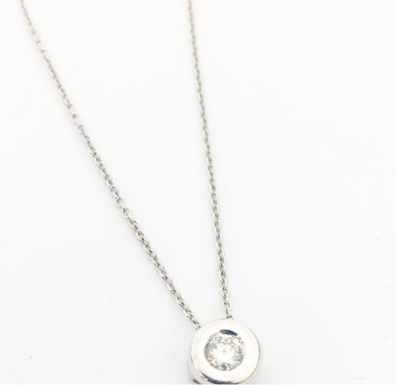 Necklace - Estate piece! .15ct diamond bezel set in 14kw gold on a sterling silver chain, 17 chain.