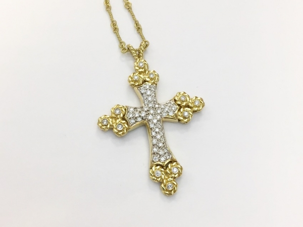 Necklace - Estate Piece! Cassis 18K yellow gold and diamond cross pendant set with 51 full cut round diamonds weighing .77cts suspended from 18 inch yellow gold chain.
