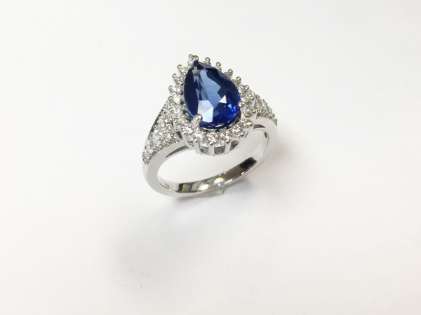 Fashion Ring - New piece! 3.30ct AGL certified pearl shaped sapphire accented with .53ctw of diamonds in 18kw gold, size 6.