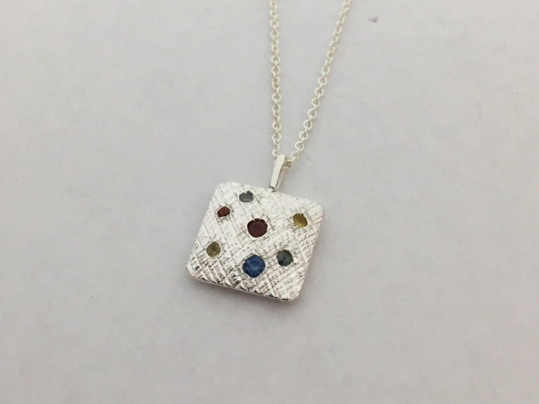 Necklace - New piece! Nina Nguyen 12x12mm multi color sapphire pendant in sterling silver on a 1mm sterling silver cable chain that can be worn at 16 or 18 inches.