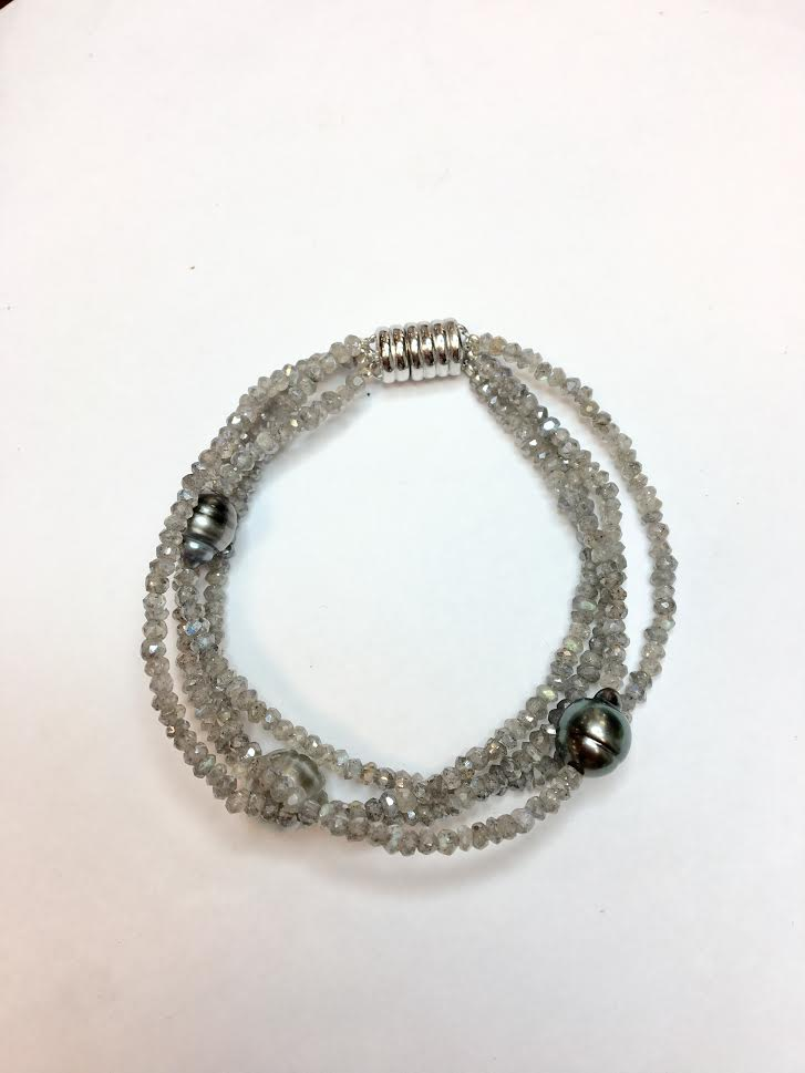 Bracelet - New Piece! 8mm to 9.54mm Tahititan pearls accented by labradorite faceted beads on a three strand with silver magnetic clasp.