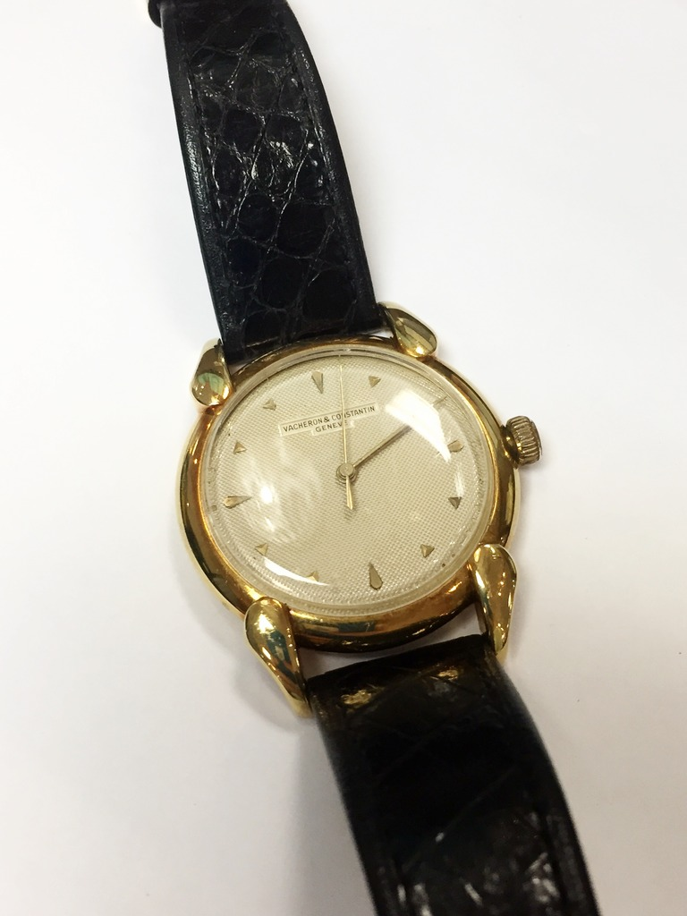 Watch - Estate piece! Vacheron & Constantin 18ky gold watch with black leather band.