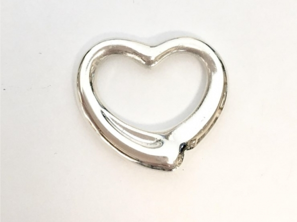 Charm - Estate piece! Tiffany and Co sterling silver heart pendant 1 inch.