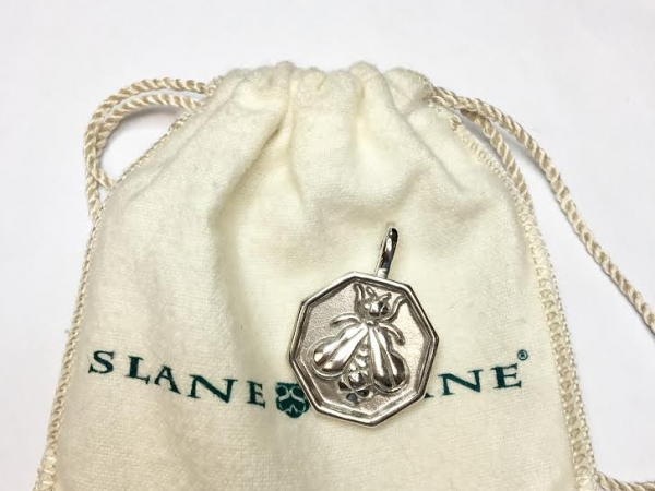 Charm - Estate Piece!  Slane .75 inch bee enhancer pendant with pouch.  Retail $495.