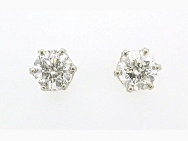 Earrings - Round brilliant cut diamond studs weighing 1.08 carat total weight with J color SI-2/I-1 clarity set in 14K white gold.