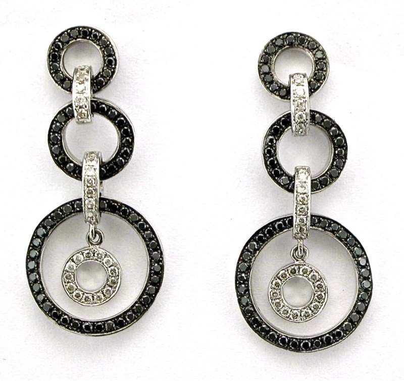 Earrings - 14K white gold earrings with black and white diamonds weighing 1.40 carat total weight.