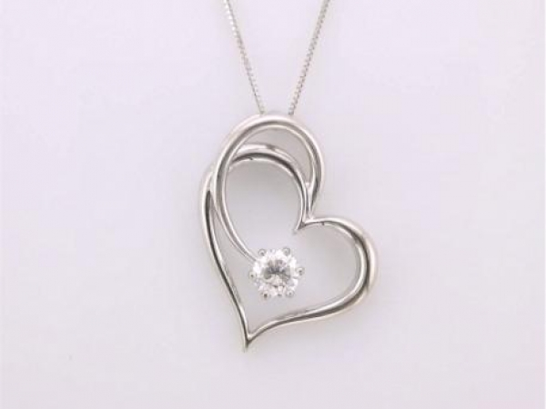 Pendant - 14kt white gold heart pendant set with a .42 carat round brilliant cut diamond with I color and I1 clarity