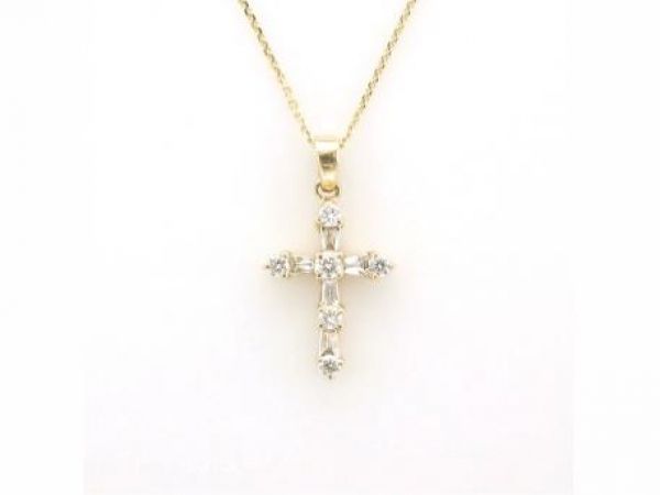 Pendant - 14kt yellow gold cross set with baguette and round diamonds weighing .29 carat total weight