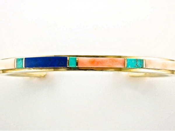 Bracelet - This beautiful Native American style 14K yellow gold cuff bracelet was originally purchased on a reservation in Northern Arizona in the mid 1980's, and it features inlaid pink coral, white coral, turquoise, and lapis separated by gold bars. This is a smaller bracelet, fitting a 6.5 to 7 inch wrist.