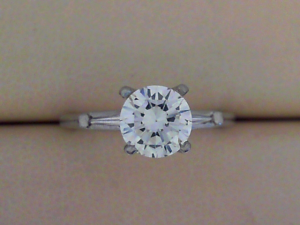 Engagement Ring - Platinum Engagement Ring With 1.29 Ct Brilliant And Side Baguette Diamonds. 1.39 CTW.