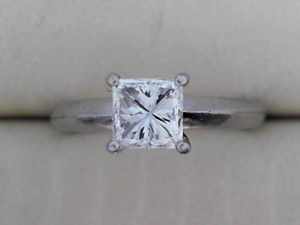 Engagement Ring - Lady's solitaire engagement ring in Platinum with 0.81 Carat Princess cut diamond, GIA: VVS2 / D Color