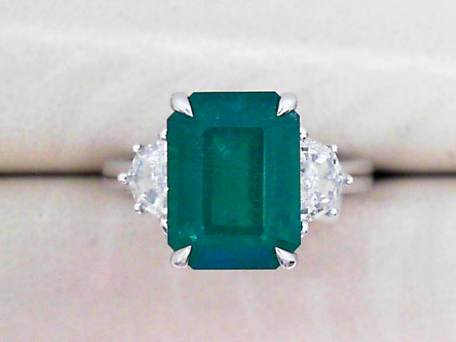 Fashion Ring - Lady's 18K W Ring With 4.24 Ct Emerald And 2-Moon Cut Diamonds Totaling 0.51 Carat.