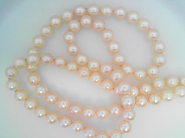 Pearl Necklaces - A 24-Inch Strand Of 7 - 7.5 mm White Cultured Pearls With 14 Y Clasp