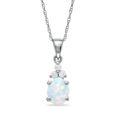 SEMI-PRECIOUS PENDANTS - 10 KARAT WHITE GOLD OVAL OPAL AND DIAMOND PENDANT ON CABLE CHAIN WITH .26 CARAT OPAL AND 3 DIAMONDS .03 CTW