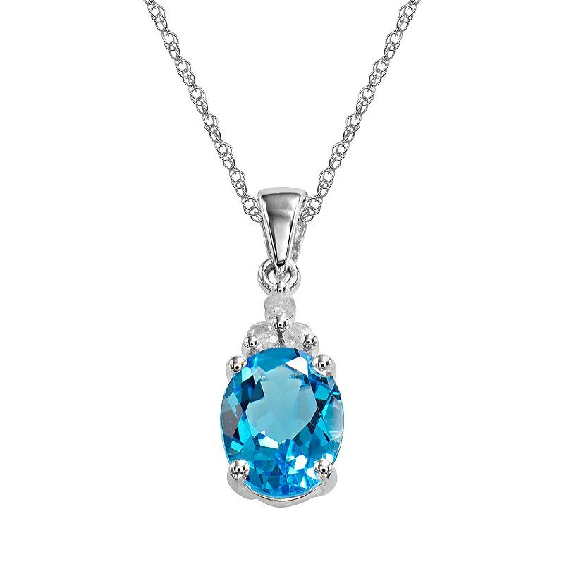 SEMI-PRECIOUS PENDANTS - 10 KARAT WHITE GOLD OVAL BLUE TOPAZ AND DIAMOND PENDANT ON CABLE CHAIN WITH .43 CARAT BLUE TOPAZ AND 3 DIAMONDS .03 CARAT CARAT TOTAL WEIGHT