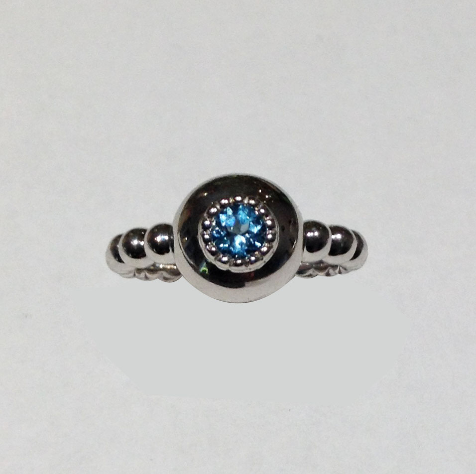STERLING SILVER RING WITH GEMSTONES - STERLING SILVER BALL SHANK RING SET WITH BLUE TOPAZ. LOVE LIFE BY RON ROSEN