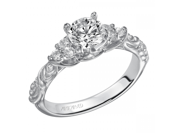 GOSSIMER - Diamond engagement ring with round center stone, clustered side diamonds and satin finished floral carving detail highlighted with diamonds. PRICES REFLECTED ARE A STARTING RANGE; ACTUAL RING COST MAY VARY. PRICES BASED ON A GOLD MARKET PRICE OF APPROXIMATELY $1,150. CALL FOR TODAY'S EXACT COST.