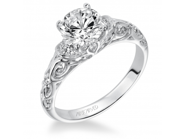 PEYTON - Diamond engagement ring with round center stone and carved diamond enhanced band. PRICES REFLECTED ARE A STARTING RANGE; ACTUAL RING COST MAY VARY. PRICES BASED ON A GOLD MARKET PRICE OF APPROXIMATELY $1,150. CALL FOR TODAY'S EXACT COST. AVERAGE AVAILABILITY IS 2-3 WEEKS, CERTAIN CUSTOM SIZES OR METALS MAY TAKE FROM 3-4 WEEKS.