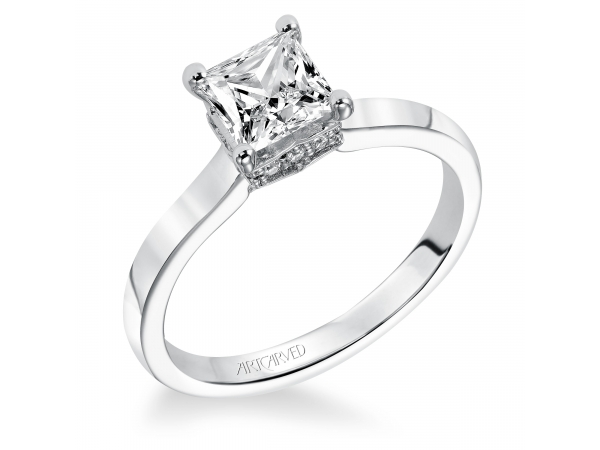 TARYN - Diamond solitaire engagement ring with princess cut center stone and pave set diamonds under the setting. PRICES REFLECTED ARE A STARTING RANGE; ACTUAL RING COST MAY VARY. PRICES BASED ON A GOLD MARKET PRICE OF APPROXIMATELY $1,150. CALL FOR TODAY'S EXACT COST. AVERAGE AVAILABILITY IS 2-3 WEEKS, CERTAIN CUSTOM SIZES OR METALS MAY TAKE FROM 3-4 WEEKS.