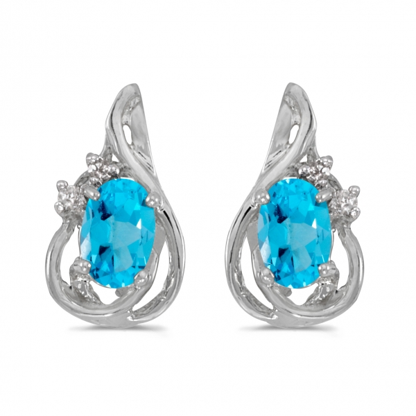 14k White Gold Oval Blue Topaz And Diamond Teardrop Earrings by Color Merchants