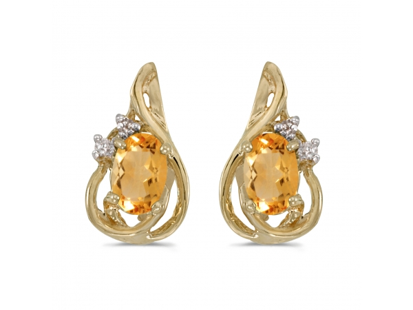 10k Yellow Gold Oval Citrine And Diamond Teardrop Earrings - These 10k yellow gold oval citrine and diamond teardrop earrings feature 6x4 mm genuine natural citrines with a 0.62 ct total weight.