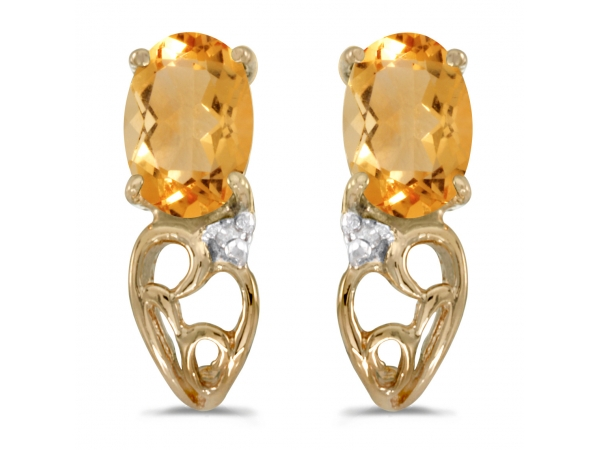 14k Yellow Gold Oval Citrine And Diamond Earrings - These 14k yellow gold oval citrine and diamond earrings feature 6x4 mm genuine natural citrines with a 0.62 ct total weight and .01 ct diamonds.