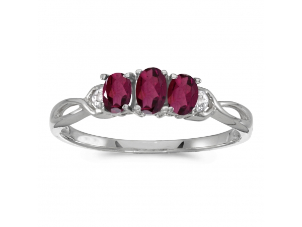 10k White Gold Oval Rhodolite Garnet And Diamond Three Stone Ring - This 10k white gold oval rhodolite garnet and diamond three stone ring features a 5x3 mm / 4x3 mm genuine natural rhodolite garnet with a 0.63 ct total weight.