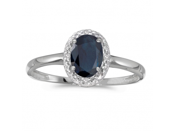 10k White Gold Oval Sapphire And Diamond Ring - This 10k white gold oval sapphire and diamond ring features a 7x5 mm genuine natural sapphire with a 0.80 ct total weight.