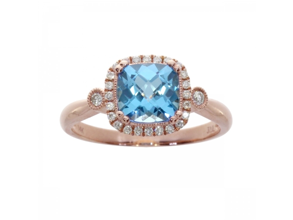 14k Rose Gold Cushion Cut Blue Topaz and Diamond Ring - A vibrant 7 mm blue topaz ring with .16 total carat diamonds.