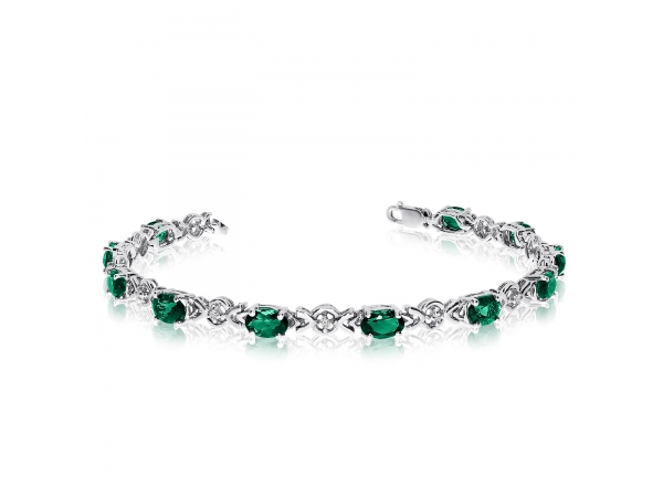 10K White Gold Oval Emerald and Diamond Bracelet - This 10k white gold oval emerald and diamond bracelet features eleven 6x4 mm stunning natural emerald stones with a 3.41 ct total gem weight.