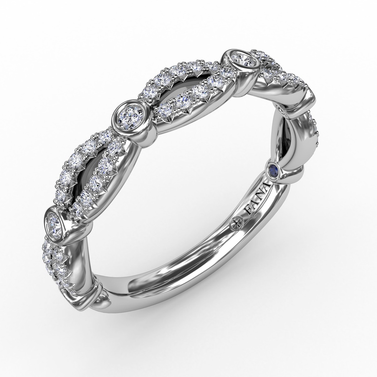 Scalloped Diamond Band with Diamond Bezel Stations - Open and airy, you will want to always keep our scalloped diamond band within reach for the multitude of ways it can be worn. Wear it alone, stacked, or to enhance your engagement ring.  This band is available in Platinum, 18KT & 14KT gold and can be customized through an Authorized Fana Retailer.